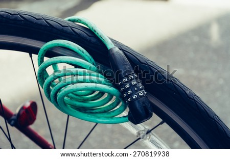 Number Lock on a Bike - soft focusin vintage style - stock photo
