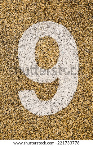 Number Nine sign on sand fome ,safety floor on playground. - stock photo
