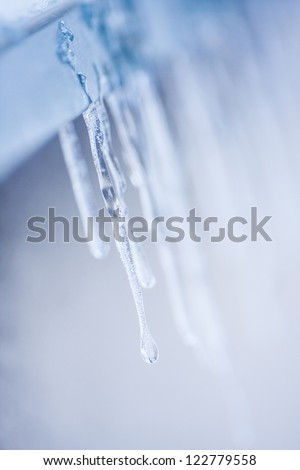 Number of icicles emerged on window ledge during cold winter - stock photo