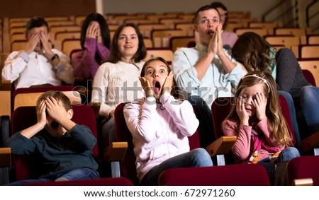 Number of people enjoying scary film in in cinema house