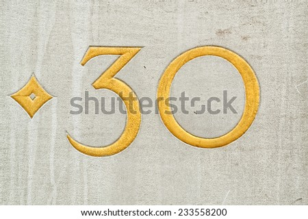 Number 30 on a wall - stock photo