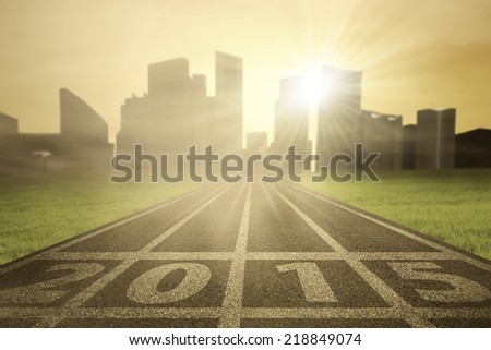 Number 2015 on race track in the morning with sunlight - stock photo