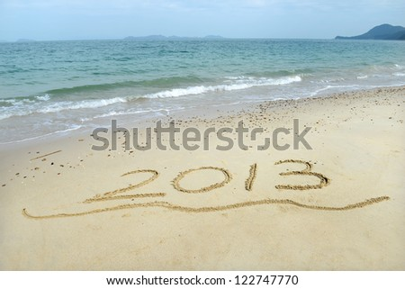 number 2013 on the beach of sunrise
