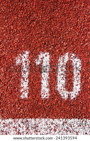 number on the running track rubber standard red color - stock photo