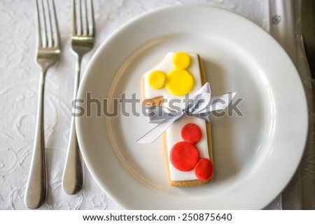number one shaped birthday cake with baw in white plate - stock photo