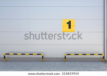 Number One Sign at Warehouse Building - stock photo