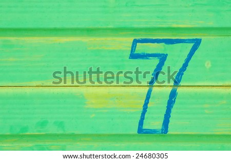 number 7 painted a battered metal door - stock photo