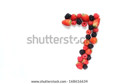 Number seven made from strawberry, raspberry and blackberry fresh fruits - stock photo