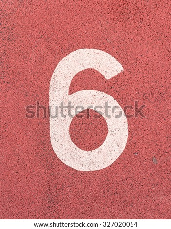 Number six,White track number on rubber racetrack, texture of running racetracks in small stadium. - stock photo