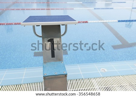 number 1 swimming pool jump plunge - stock photo