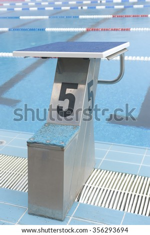 number 5 swimming pool plunge  - stock photo