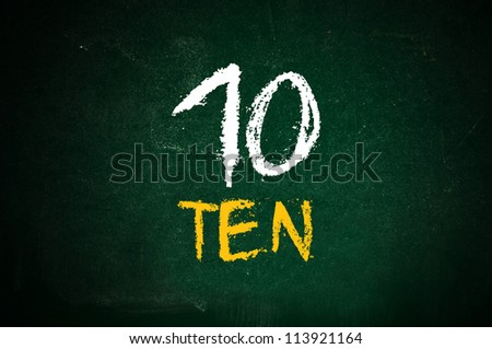 Number ten, handwritten number ten with a chalk on a green chalkboard. - stock photo