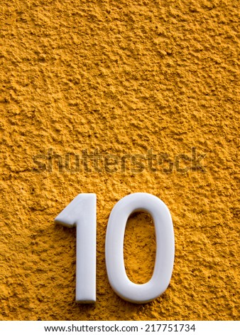 number ten  on a house wall - stock photo
