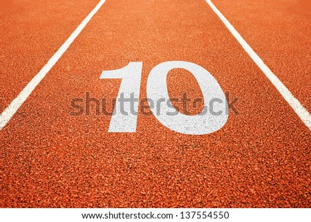 Number ten on athletics all weather running track - stock photo