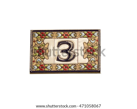 Number three in a ceramic tile on street