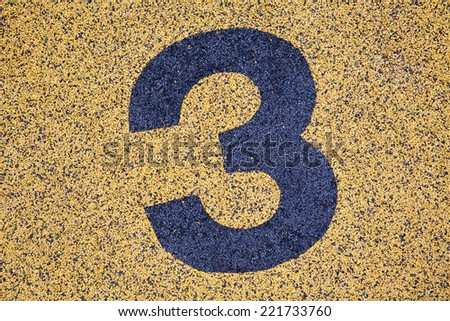 Number Three sign on sand fome ,safety floor on playground. - stock photo