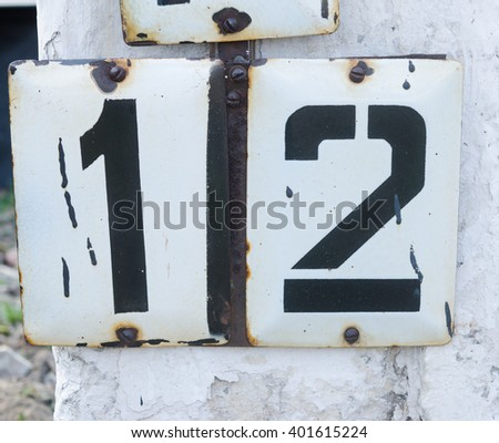Number twelve typed on the metal plate - stock photo