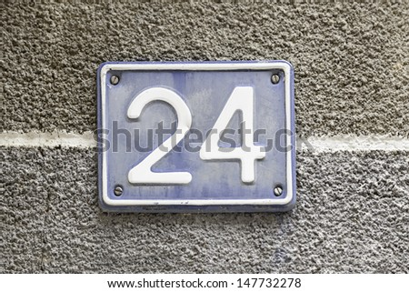 Number twenty, detail of a plaque in the town with the number twenty four, signal and symbol, figure - stock photo