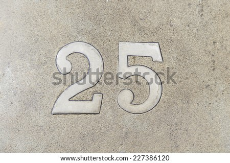 Number twenty in a wall of a house, detail of a number of information, odd number - stock photo