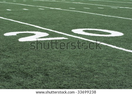 number 20 twenty on an american football field - stock photo