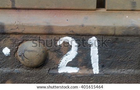Number twenty-one typed on the metal plate - stock photo