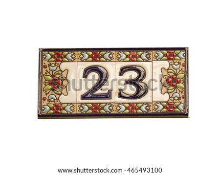 Number twenty three in a ceramic tile on street