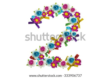 Number two, created by little flowers and colorful bows on the white background
