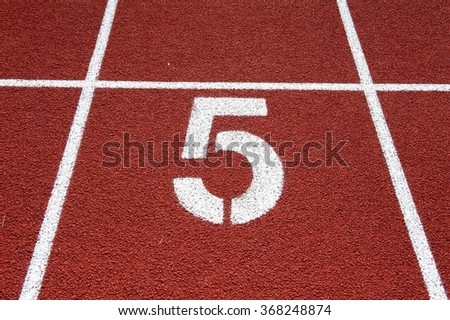 Number two on the start of a running track - check my portfolio for other numbers - stock photo