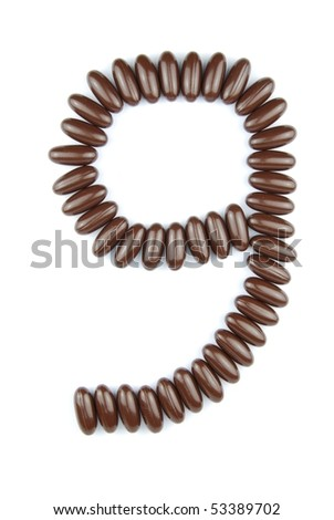number 9 with chocolate candies (isolated on white background)