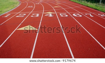 Numbered lanes on a track. - stock photo