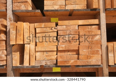 Numbered wood planks stacked at lumber mill in Ontario, Canada
