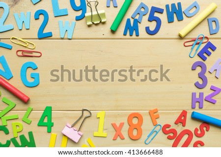 Numbers and English alphabets on wooden background ready for text