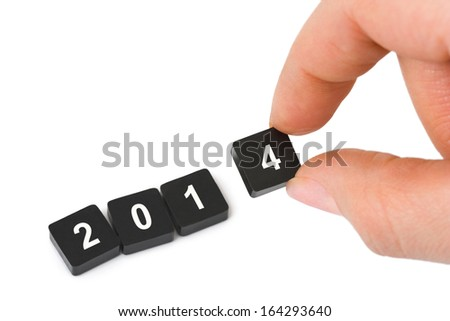 Numbers 2014 and hand isolated on white background - stock photo