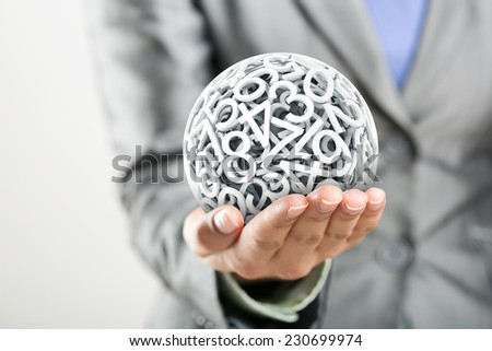 Numbers forming a sphere on the women's hand - stock photo
