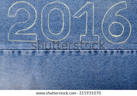 Numbers 2016 of chalk contour on the background of the jeans. Christmas theme. - stock photo