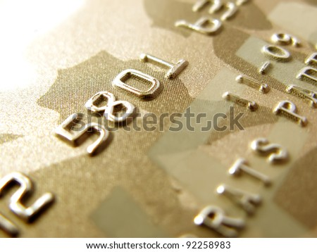 Numbers of golden credit card in very close up - stock photo