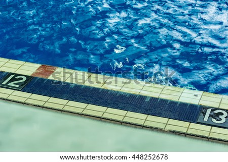 Numbers of pool lanes by the waters edge. - stock photo