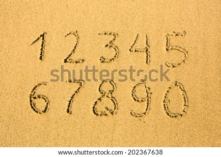 Numbers on a sandy beach (0-9) - stock photo