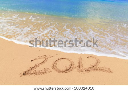 Numbers 2012 on beach - concept for summer and holiday - stock photo