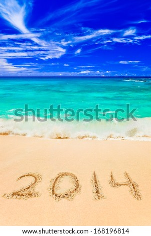 Numbers 2014 on beach - concept holiday background - stock photo