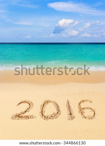 Numbers 2016 on beach - concept holiday background
