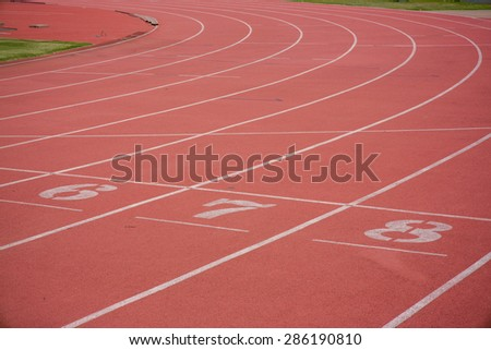 Numbers on running track  in stadium - stock photo