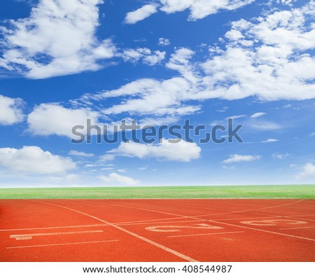 Numbers on running track with blue sky background