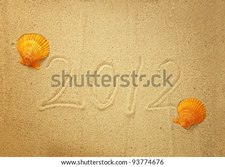 Numbers 2012 on tropical beach sand with shell - stock photo
