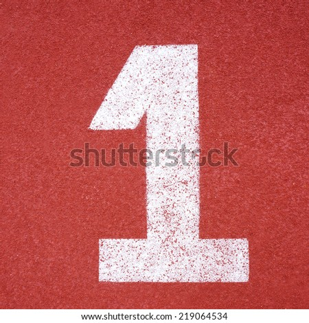 Numbers one on red running track