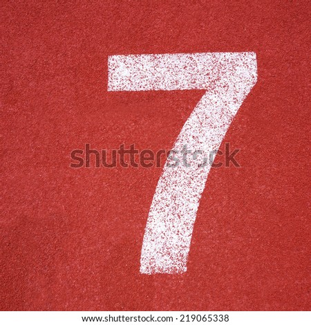 Numbers seven on red running track - stock photo