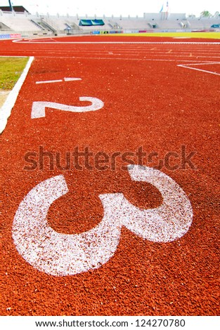"Numbers ""1"" to ""3"" on running track at arena."