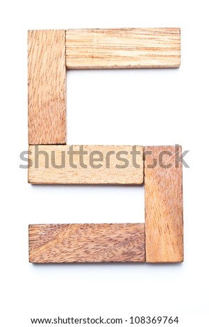 Numbers 5 with wooden floors and white. - stock photo