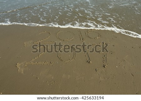 numbers written in the sand/ numbers/ numbers written in the sand at the beach