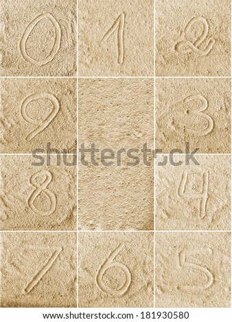 Numbers written on a sand (from 0 to 9) - stock photo